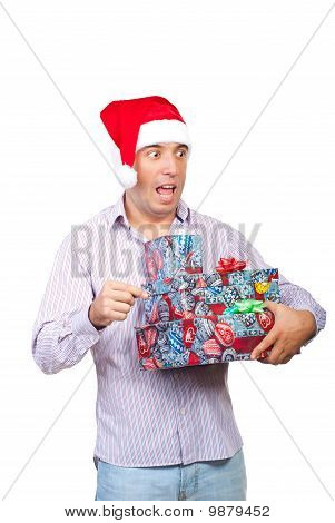 Surprised Man Holding Christmas Gifts