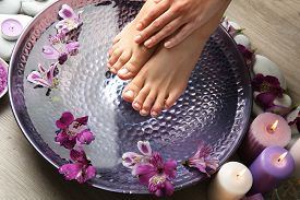 image of pedicure  - Female feet at spa pedicure procedure - JPG