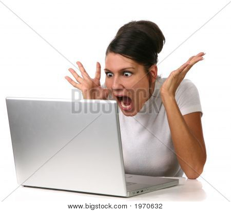 Female Shocked At Something On Her Computer