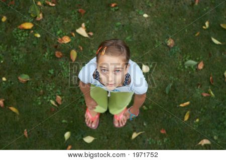 Young Girl On The Grass