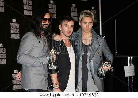 LOS ANGELES - SEP 12:  Tomo Milicevich, Shannon Leto and Jared Leto of 30 Seconds to Mars in the Press Room  at the 2010 MTV Video Music Awards  at Nokia on September 12, 2010 in Los Angeles, CA