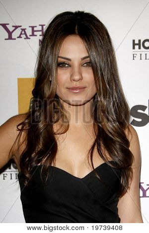 LOS ANGELES - OCT 25:  Mila Kunis arrives at the 14th Annual Hollywood Awards Gala at Beverly Hilton Hotel on October 25, 2010 in Beverly Hills, CA