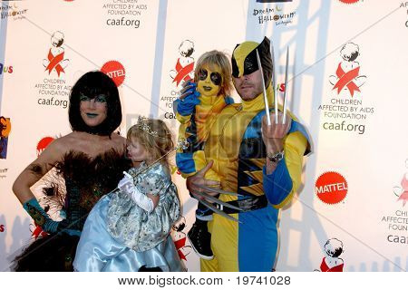 LOS ANGELES - OCT 30:  Tori Spelling, daughter Stella, son Liam, husband Dean McDermott arrive at the 17th Annual Dream Halloween at Barker Hanger on October 30, 2010 in Santa Monica, CA