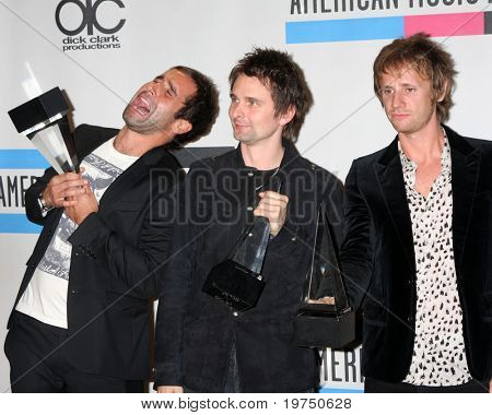 LOS ANGELES - NOV 21:  Muse - Christopher Wolstenholme, Matthew Bellamy and Dominic Howard in the Press Room of the 2010 American Music Awards at Nokia Theater on November 21, 2010 in Los Angeles, CA