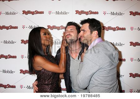 LOS ANGELES - FEB 26:  Brandy Norwood, Maksim Chmerkovskiy and Tony Dovolani  arrive at the Rolling Stone Pre-Oscar Bash 2011 at W Hotel on February 26, 2011 in Hollywood, CA
