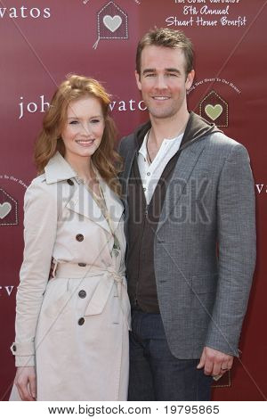 LOS ANGELES - MAR 13:  Kimberly Brook. James Van Der Beek arriving at the John Varvatos 8th Annual Stuart House Benefit at John Varvaots Store on March 13, 2011 in Los Angeles, CA