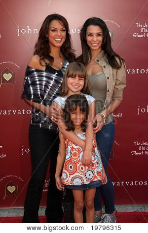 LOS ANGELES - MAR 13:  Eva LaRue, Daughter Kayla, sister Lara La Rue and niece arriving at the John Varvatos 8th Annual Stuart House Benefit at John Varvaots Store on March 13, 2011 in Los Angeles, CA