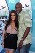 LOS ANGELES - AUGUST 8:  Khloe Kardashian & Lemar Odom arrive at the 2010 Teen Choice Awards at Gibs