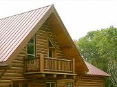 stock photo of log cabin  - A lovely detailed balcony of a log cabin in the woods - JPG