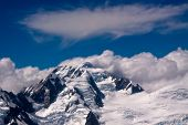 Southern Alps And Clouds - New Zealand