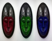 foto of african mask  - A colourful image of three african face masks in RGB - JPG