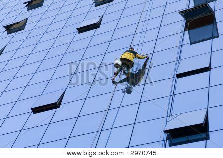 Worker Washing Windows