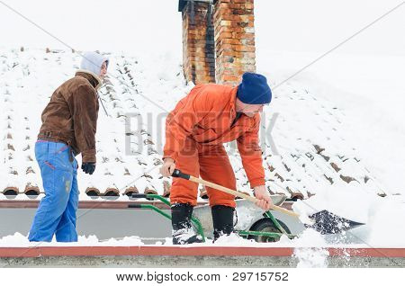 Two men cleaning snow