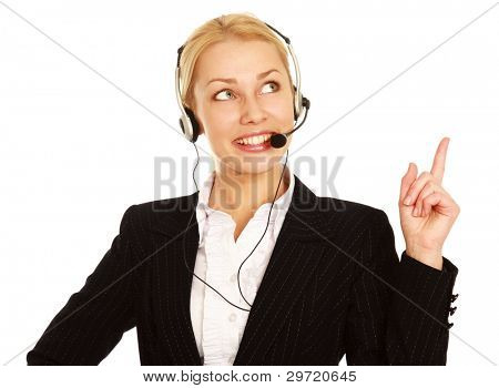 Portrait of happy customer support phone operator in headset pointing at something, isolated on white background