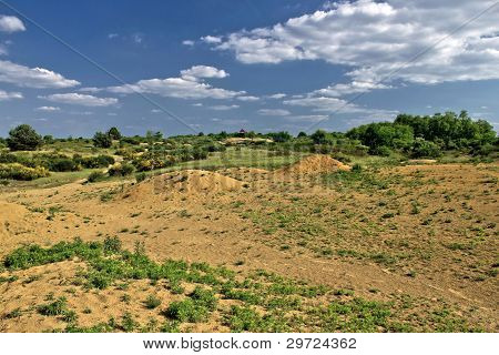 Colorful European Desert Landscape Under Blue Sky