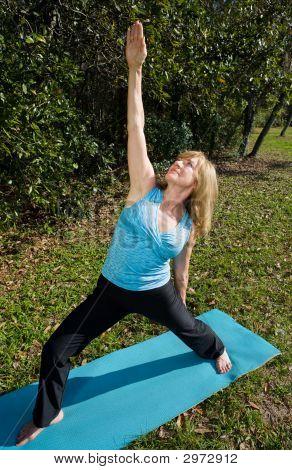 Mature Woman Yoga - Upward Warrior