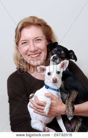 Woman Holding 2 Small Dogs