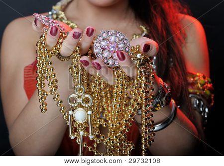 Jewel in hands of woman