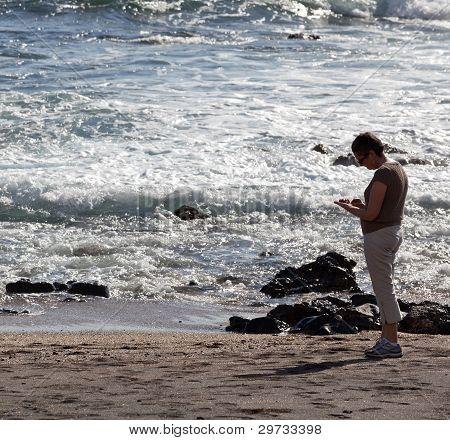 Woman Beachcomb On Glass Beach