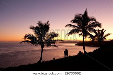 Couple Watching Sunrise In Kauai