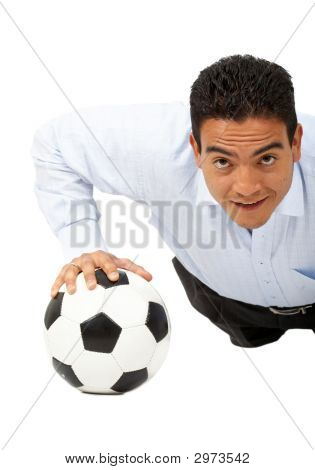 Business Man Exercising On A Football