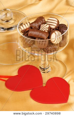 Chocolate Pralines And Heart Shapes
