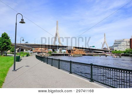 Boston Leonard P. Zakim Bunker Hill Memorial Bridge with blue sky as the famous land mark over Charles River.