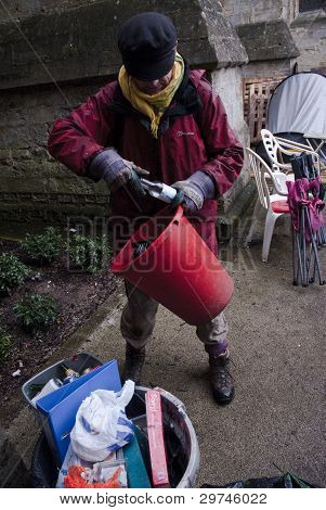 Occupy Exeter Ghee Bowman clears away rubbish from Exeter Cathedral Green,