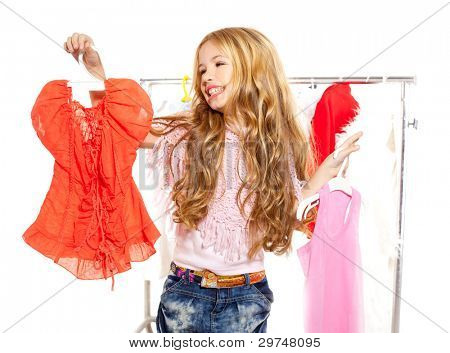 fashion victim kid girl at backstage wardrobe choosing clothes
