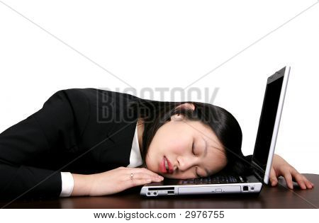 Asian Girl Sleeping On Computer