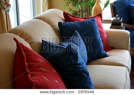 Cushions Resting On Formal Couch In Modern Home