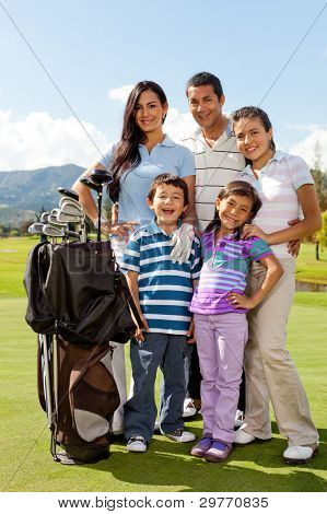 Beautiful family at the golf field looking happy
