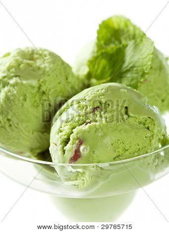 Three Scoops of Pistachio Ice Cream with Fresh Mint