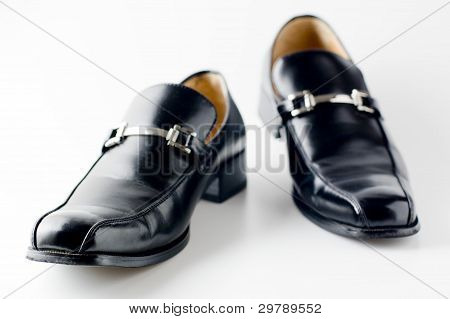 Black shiny dress shoe.