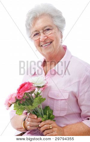 Senior Woman With A Bunch Of Flowers