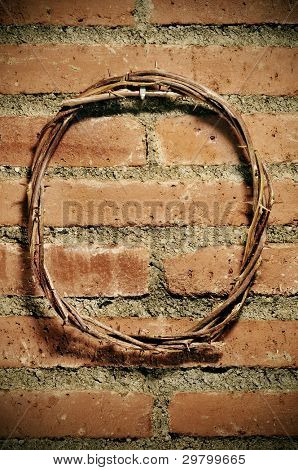 a representation of the Jesus Christ crown of thorns hanging on a brick wall
