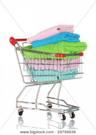Shopping cart and towels isolated on white