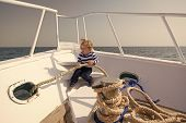 Travelling Concept. Little Child Enjoy Travelling On Ship. Baby Boy Travelling By Sea. Travelling On poster