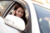 woman in car with mobile phone