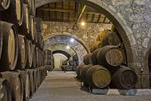 wooden wine barrels in cellar