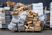 Stacks Of Wooden And Plastic Boxes At Warehouse In Store Yard. Used Boxes And Containers For Transpo poster