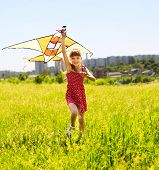 picture of children playing  - Child flying kite outdoor - JPG