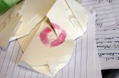 stock photo of loveless  - Envelope with lipstick lies in the trash can - JPG