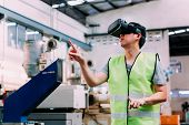 Industrial Factory And Manfacturing Engieering Worker Wearing Vr Goggle Headset Touching In Virtual  poster