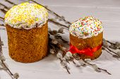 Easter Cakes With Pussy Willow Branches On White Wooden Table poster