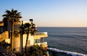 pic of beach-house  - Picture of a house on the shoreline on the sunset - JPG