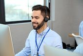 Technical Support Operator With Headset Working In Office poster