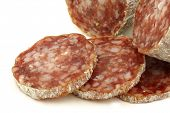 spicy Italian salami sausage and slices on a white background poster