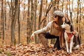 Animal Husbandry. Girl Pretty Stylish Woman Walking With Husky Dog Autumn Forest. Unconditional Love poster