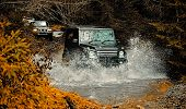 Mud And Water Splash In Off-road Racing. Off Road Sport Truck Between Mountains Landscape. Expeditio poster